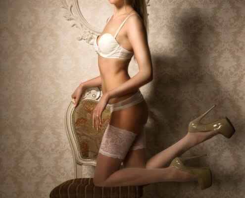 Escorts in Las Vegas | Suzanna White Lingerie Stockings Kneeling Photo | Girls Direct To You