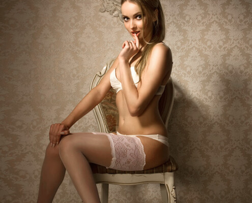 Call Girls in Las Vegas | Suzanna White Lingerie Stockings Sitting Photo | Girls Direct To You