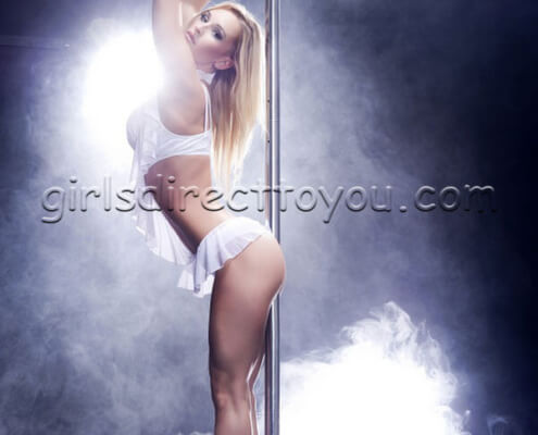 Las Vegas Strippers to Your Room | Charlotte Stripper Pole Standing Photo | Girls Direct To You
