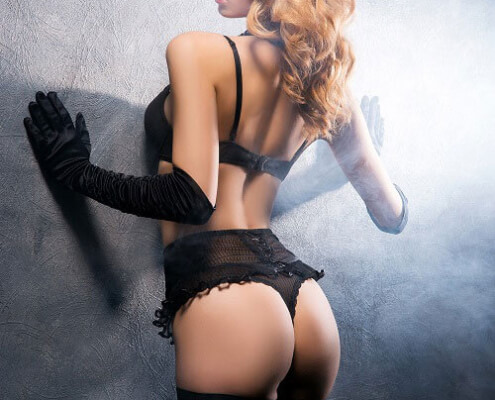 Curvy Escorts Las Vegas | Nadia Against the Wall Photo | Girls Direct To You